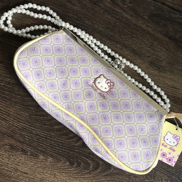 Loungefly Handbags - Hello kitty Sanrio lavender and yellow clutch.